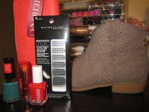 Revlon Nail Color in Trendy, Maybelline Color Whisper in Coral Ambition, Essie nail color in Snap Happy, Maynelline color show fashion prints in Metal Prisms, Merona zip around coral wallet and Mossimo paka ankle booties.