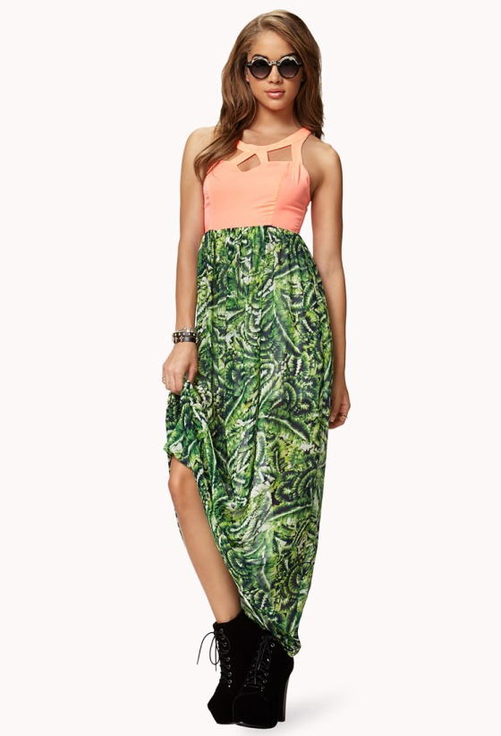 Sleeveless maxi dress with a caged neon bodice and tropical leaf skirt, racerback and cutout lower back detail. South of the Equator Maxi Dress- $37.80