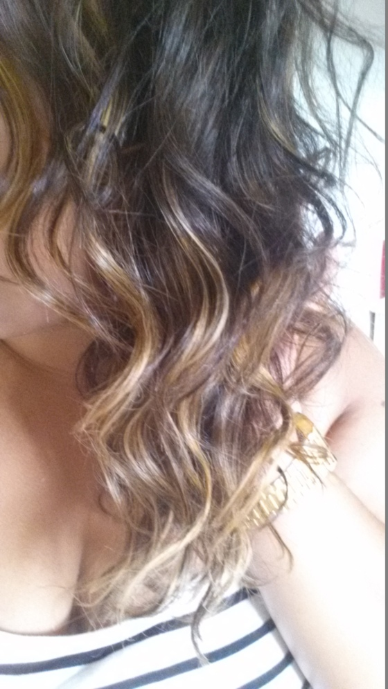 I curled all of my hair, once I was finished I opened up the curls to create the wavy look I was going for