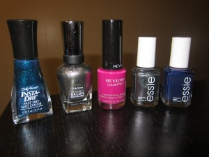 "From Left to right: Sally Hansen ""Teal-y Fast"" & ""Shoot the Moon"", Revlon ""Rich Raspberry"", Essie ""For the twill of it"" & ""No more film"