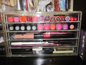 Lip tints, stains and balms in top row, Lipsticks in second, Glosses in the third, lip, eye liners and highlighters in the fourth and shadows in the fifth.