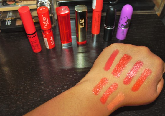 Top four hand swatches from left to right: NYX butter gloss in  Peach Cobbler NYX lip butter in Hot Tamale Maybelline Vivids in Vibrant Mandarin Milani in Sweet Nectar Bottom hand swatches from left to right: Revlon Just Bitten balm in Rendezvous MAC amplified lipstick in Morange Limecrime lipstick in Cosmopop