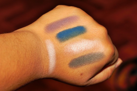 Swatches of a few shades from the Lorac Pro 2 palette Top color is the shade Plum, followed by Navy, then Rosé and Jade. Shade on the left side is called Beige